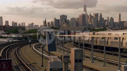 Brooklyn train departing from Smith and 9th st elevated subway station with Manhattan skyline in background in 4K and 1080 HD