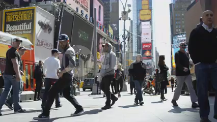 kid breakdancing in Times Square on bright sunny day - 4K slow motion