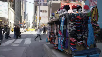 hats being sold by street vendor in Times Square during day - 4K slow motion in NYC