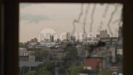 map of New York City on subway station window in Brooklyn with Empire State Building rack focus