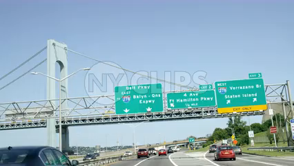 driving under sign for Staten Island with Verrazano Bridge from driver POV - 4K highway in NYC