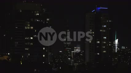 Empire State Building lighting up at night in Manhattan NYC