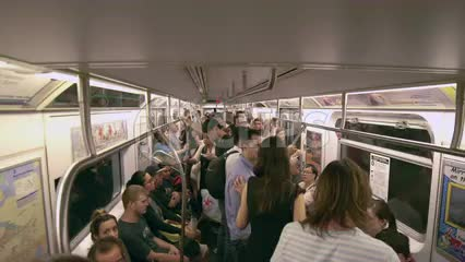 moving subway train interior - people on crowded carriage in summer - New York City