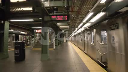 subway train departing station platform at Times Square stop in NYC