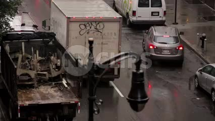 firetruck honking in traffic with siren and flashing lights - FDNY fire truck - raining in NYC