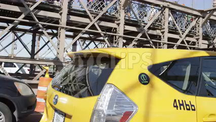 driving across Brooklyn Bridge - caravan taxi cab crossing alongside driver's side pov in 4K NYC