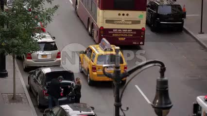 FDNY fire truck honking in traffic - emergency siren and turret lights flashing in NYC
