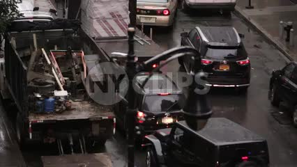 police siren in traffic - NYPD cop car with turret lights flashing in rain on NYC street