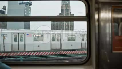 window view of other subway train on elevated track