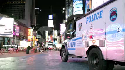 NYPD police truck parked in Times Square at night