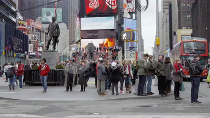 crowded Times Square street corner - tourists in slow motion on busy New York City on cold winter day in 4K