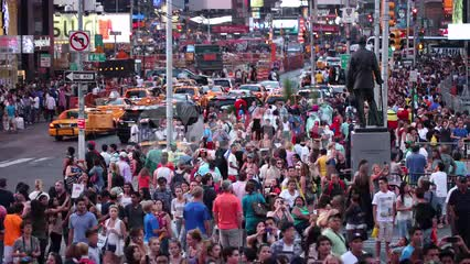 Times Square with crowd of people swarming street in summer