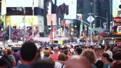 Times Square with many people walking - crowded in street on summer night