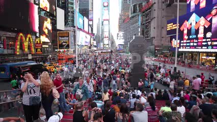 Times Square crowded with people on summer day