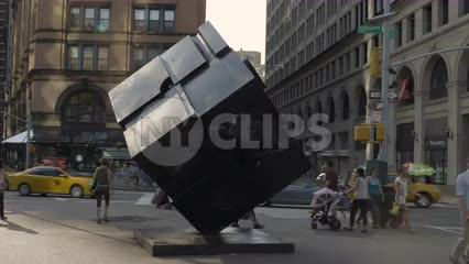 famous cube sculpture in Cooper Square on summer day