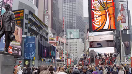 moving through crowded Times Square busy with people - tourists visiting New York City on cold winter day in 4K slow motion