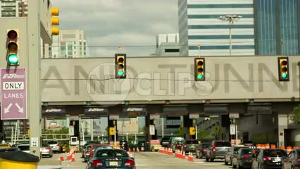 approaching Holland Tunnel tollbooth with EZ-Pass line from driving car in New Jersey