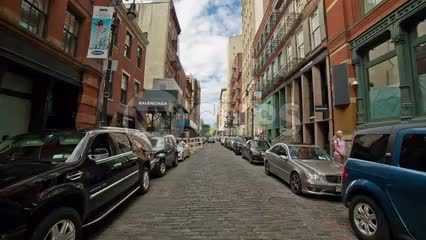 cobblestone street in SoHo on beautiful summer day