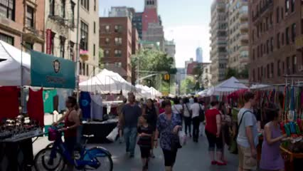 people walking in crowded street fair in Manhattan NYC