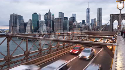 Brooklyn Bridge with Freedom Tower in Manhattan skyline day to night time-lapse in 4K and 1080 HD  NYC