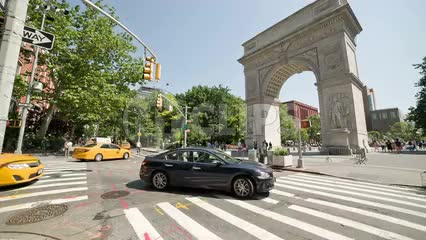 Washington Square Park North with arch monument on bright sunny day