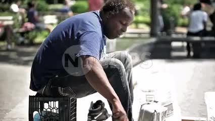 talented drummer banging pots and pans in Washington Square Park - musician performing on hot summer day in NYC
