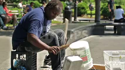 talented percussionist drumming pots pans and buckets - banging drum patterns on metal in Washington Square Park