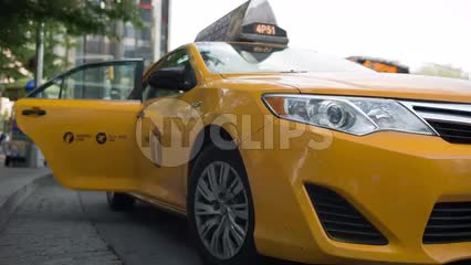 taxi cab door closing in taxicab stand at Columbus Circle in NYC