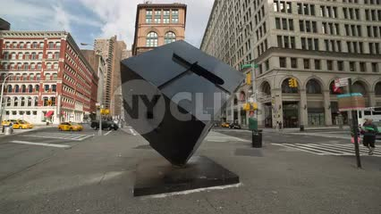 Cooper Square with famous cube sculpture on summer day in Manhattan NYC