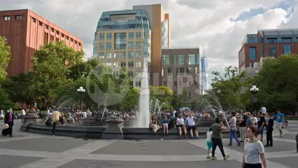 famous fountain in center of Washington Square Park in summer in NYC