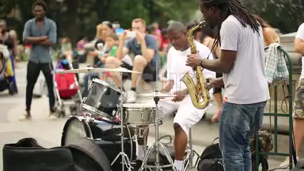 musicians playing saxophone and drums in Washington Square Park - saxophonist and drummer jamming in NYC