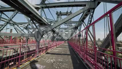Williamsburg Bridge interior, panning inside steel bars on summer day in NYC