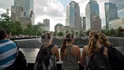 tracking by people at waterfall at Freedom Tower 911 Museum in summer in NYC