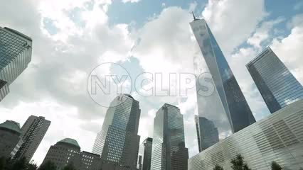 Freedom Tower tilting down to waterfall square in 911 Museum in Downtown Manhattan NYC