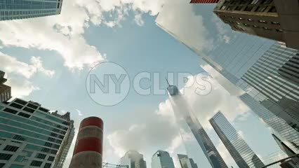 Freedom Tower towering over steaming construction pipe - orange smokestack in Downtown Manhattan in NYC