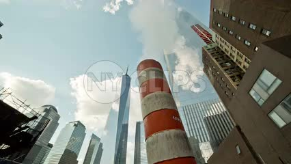 Freedom Tower with steaming construction smoke pipe in Downtown Manhattan in NYC