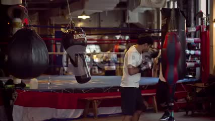 boxing gym in Lower Manhattan with people training on heavybags