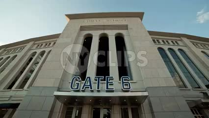 Gate 6 sign at Yankee Stadium tilting down to entrance - exterior front doors in the Bronx New York City