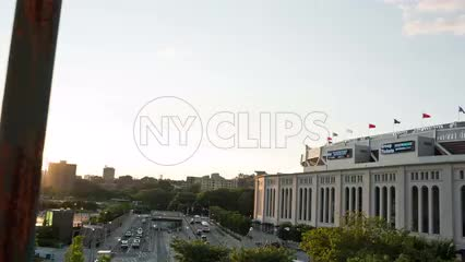 Yankee Stadium at sunset on beautiful summer day - view from elevated subway train platform in the Bronx in NYC