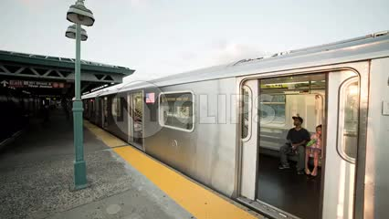 4 Train leaving 161st st subway station at Yankee Stadium - elevated platform in the Bronx NYC