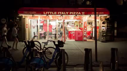 Little Italy Pizza sign - pizzeria at night in NYC