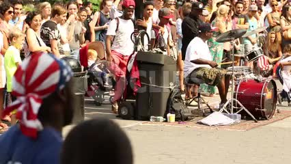musicians and street acrobat performing - drummer in Washington Square Park on summer day in NYC