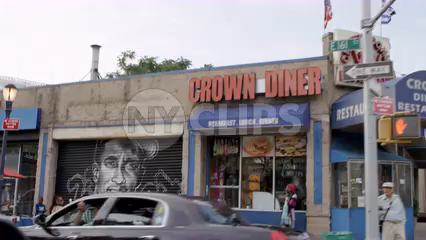 161 street in the South Bronx driving past famous Yankee sports figures murals spray painted on storefront gates - slow motion 4K NYC