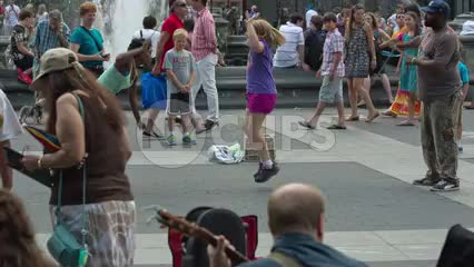 young girl playing Double Dutch in Washington Square Park on summer day in New York City