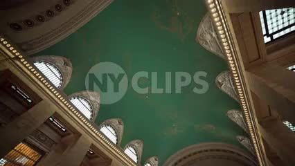 Grand Central Station Terminal interior tilting down to crowded room in summer in NYC