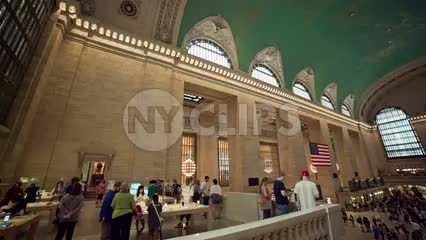 Grand Central Station Terminal panning across crowded interior with people busy traveling in summer in NYC