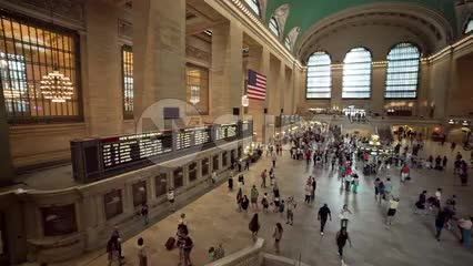 panning across interior of Grand Central Station terminal from high view in large room - summer in NYC
