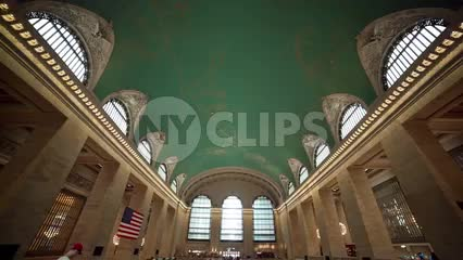 Grand Central Terminal interior with people walking downstairs in summer in New York