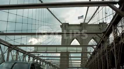 American flag on top of Brooklyn Bridge - view from car driving across in NYC