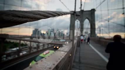 close-up of suspension rope on Brooklyn Bridge at sunset on summer day in NYC